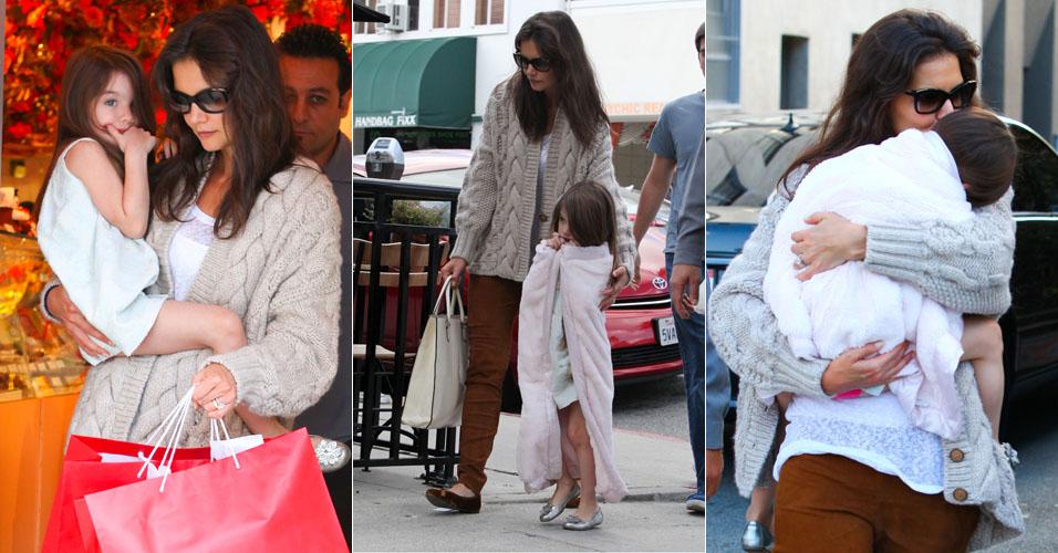 Katie Holmes leva a filha Suri Cruise para comprar chocolates em loja de Beverly Hills (24/11). Incomodada com a presença dos paparazzi, Suri escondeu o rosto no colo da mãe várias vezes. Holmes também recebeu a visita da filha durante a semana no set de gravações de seu novo filme