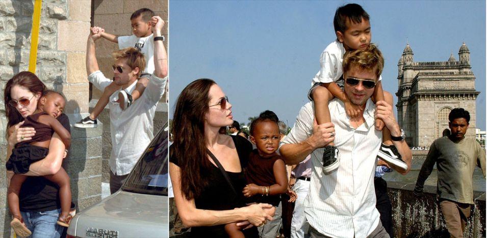Angelina Jolie e Brad Pitt caminham por ruas de Mumbai, na Índia, com os filhos Zahara e Maddox. O casal estava no país para que Jolie filmasse o longa