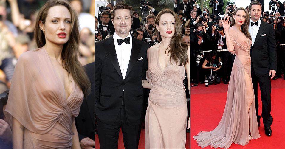 Angelina Jolie e Brad Pitt posam para foto no tapete vermelho ao chegarem para a exibição do filme