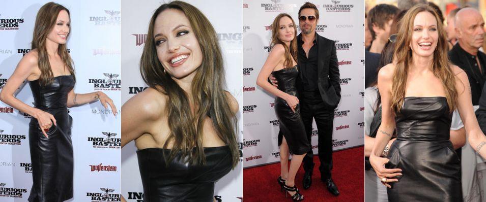 Usando um sensual vestido de couro preto e tomara-que-caia, Angelina Jolie acompanha o marido, Brad Pitt, à pré-estreia do filme