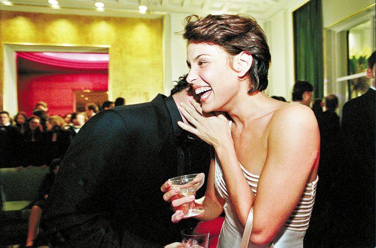A atriz Carolina Ferraz e o então namorado Murilo Benício durante festa da
