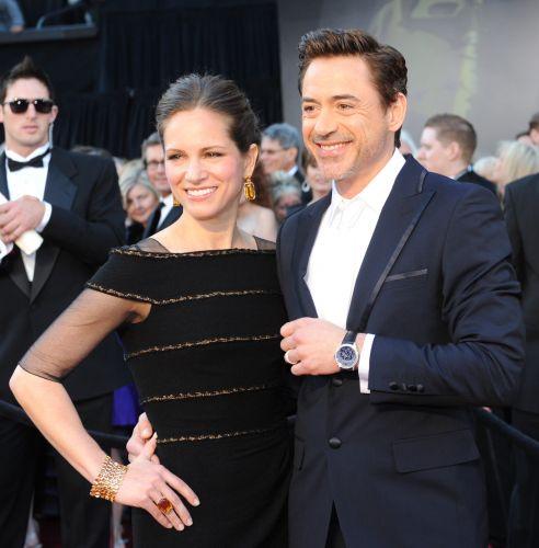 O ator Robert Downey Jr. chega com a mulher, Susan, ao 83º Oscar (27/2/11)