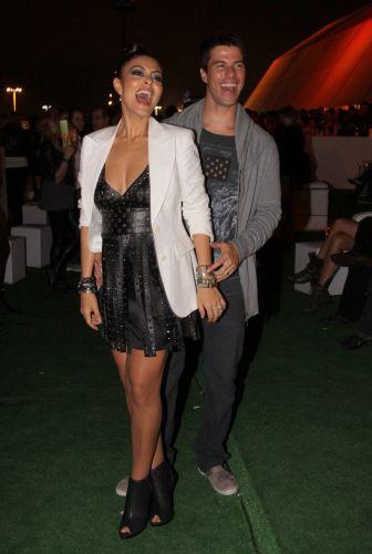 A atriz Juliana Paes foi com o marido, Carlos Eduardo Baptista, ao segundo fim de semana de show do Rock in Rio 2011 (02/10/2011)