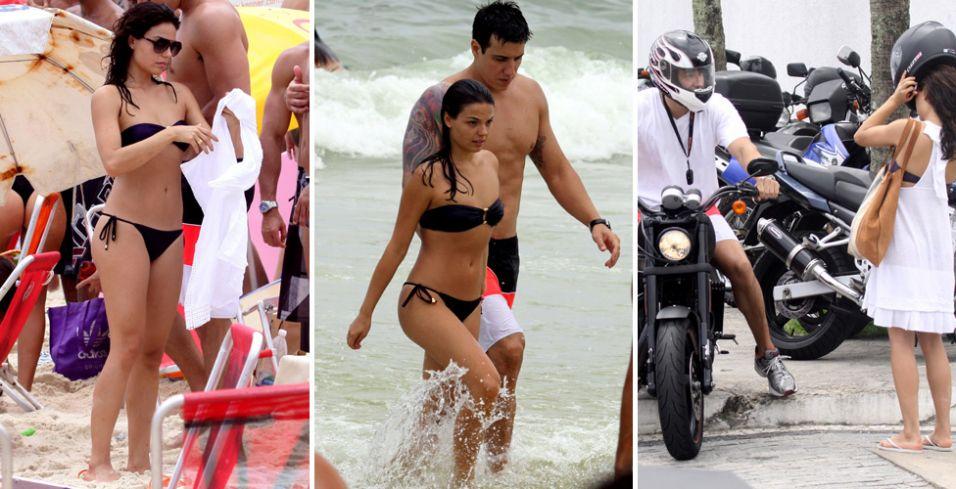 Ísis Valverde curte o sábado na praia da Barra da Tijuca acompanhada do namorado, o empresário Luís Felipe Reif Pepi, dez anos mais velho que a atriz. O casal entrou no mar e deixou a praia de moto (04/12/2010)