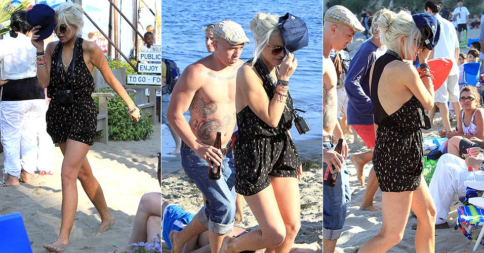 No dia seguinte de completar 25 anos, Lindsay Lohan tenta aproveitar um dia de praia na Paradise Cove, em Malibu, Califórnia (3/7/11). A atriz cumpriu recentemente 35 dias de prisão domiciliar, após falhar em um teste de consumo de álcool