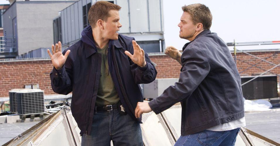 Matt Damon e Leonardo di Caprio durante cena do filme