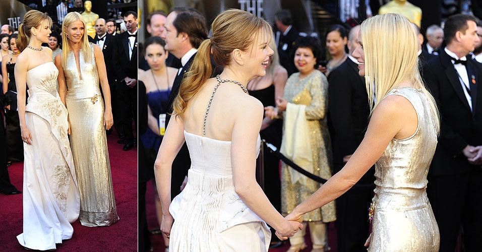 As atrizes Nicole Kidman (à esq.) e Gwyneth Paltrow se cumprimentam no tapete vermelho do 83º Oscar, no Kodak Theatre (27/2/11)