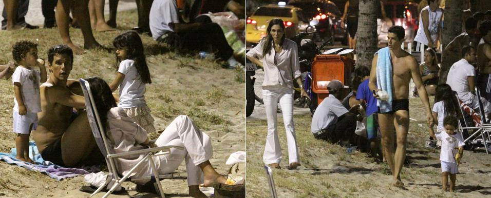 Márcio Garcia aproveita o calor do início da noite de sexta-feira com a mulher e os filhos, na praia da Barra da Tijuca, Rio de Janeiro (18/2/2011)