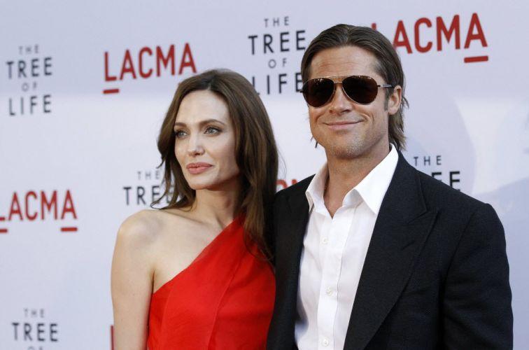 Angelina Jolie e Brad Pitt, sem barba, na pré-estreia do filme